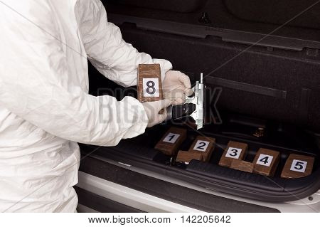 Drug bundles smuggled in a car trunk. Illegal drug trade.