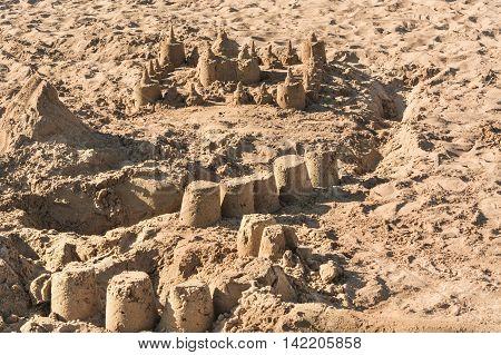 Closeup of a sandcastle on a sandy beach