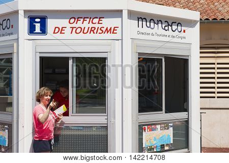 MONACO, MONACO - JUNE 17, 2015: Unidentified person gets maps and directions at the office of tourism booth in Monaco, Monaco.