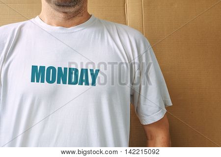 Days of the week - monday man wearing white t-shirt with name of the first weekday printed