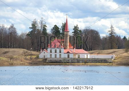 GATCHINA, RUSSIA - APRIL 24, 2016: View of Priory Palace, cloud april day. Historical landmark of the city Gatchina, Leningrad region, Russia