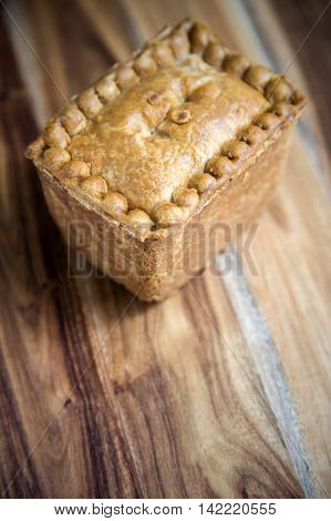Gala Pork Pie on a wooden board