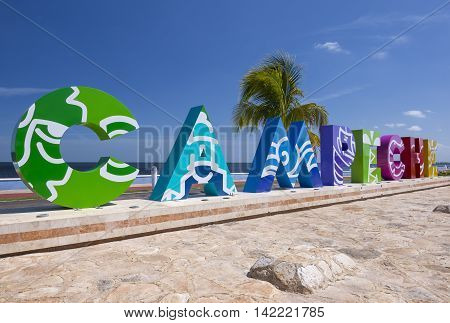 CAMPECHE, MEXICO - JULY 7, 2016: Big colorful block letters spelling Campeche offer tourists a selfie-photo opportunity with a beautiful blue sea in the background