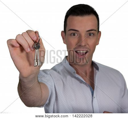 Handsome young caucasian man with exicted expression and keys in his hand