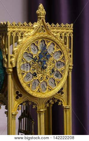 YAROSLAVL, RUSSIA - JUNE 30, 2016: A mantel clock in gothic style made in Western Europe in the end of the XIX century. The mantel clock is located in The Foreign Art Museum in Yaroslavl.
