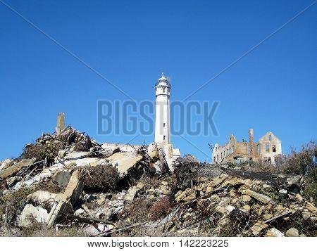 San Francisco, USA - October 22, 2008: Lighthouse and old ruins of Alcatraz prison on Alcatraz island (San Francisco, California, USA)