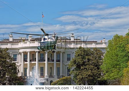 Closer view at the helicopter flying in front of the White House in Washington D.C. USA. It was established in 1800. Serves as an official residence and workplace for the US President.