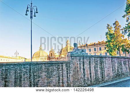 Roman Walls And Piazza Del Popolo In Rome In Italy