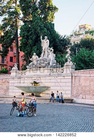 Tourists And Fountain At Piazza Del Popolo In Rome Italy