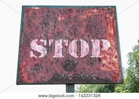 Stop text message on the board of grungy background.