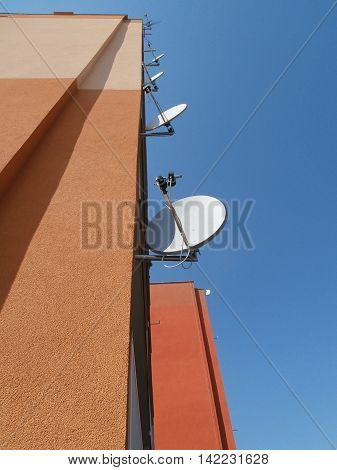 Prefab wall with satellites and blue sky
