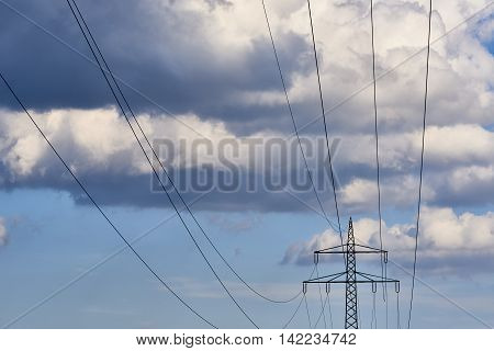 Power transmission gridline in front of dramatic sky