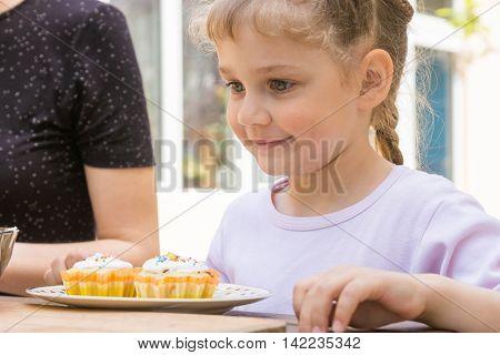 Happy Girl Is Preparing To Eat Easter Cupcakes