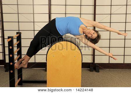 Pilates Stretch On Barrel