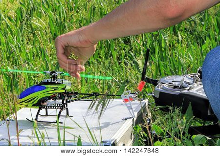 Piloting Radio controlled helicopter with remote control.