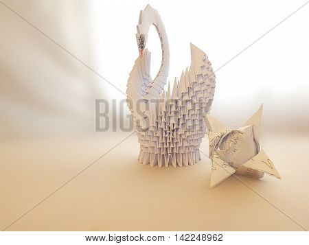 Swan made of paper for the interior, with folded napkins in the form of tulip flowers, White background