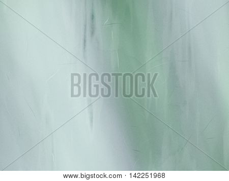 Background simulates blurred blue and green paint.