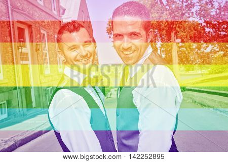 A Portrait of a loving gay male couple on their wedding day. The photo is taked on the Quebec city street.