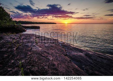 Sunrise On The Inland Sea. Sunrise horizon over the waters of Lake Superior in Michigan's Upper Peninsula.