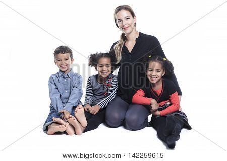 A family sitting on the floor of a photography studio
