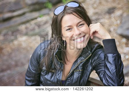 A 30 years old beautiful woman portrait in nature with sunglasses