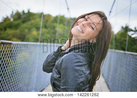A 30 years old beautiful woman portrait in little bridge