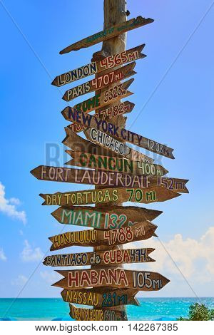 Key West beach distance signs to worldwide landmarks Florida USA Fort Zachary Taylor
