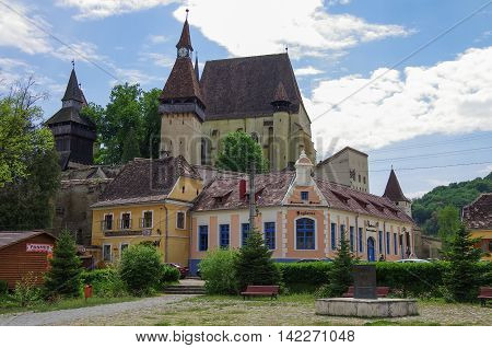 Biertan, Romania - May 2, 2014: Tourist Saxon village with fortified church (castle) in Transylvania.