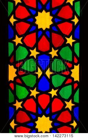 SHIRAZ IRAN - Aprill 30 2016: Detail of stained glass window in Nasir al Molk or Pink Mosque in Shiraz Iran.