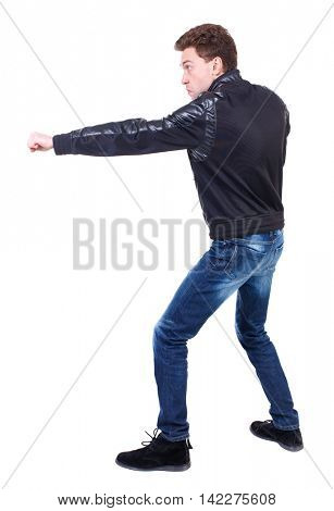 back view of guy funny fights waving his arms and legs. Isolated over white background. Rear view people collection.  backside view of person. Curly guy in a black leather jacket fun waving his arms.