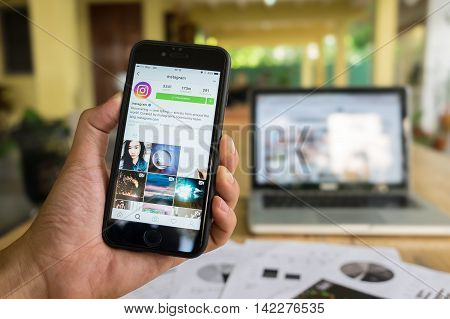 CHIANG MAI THAILAND - JULY 7 2016: A man hand holding iphone with new logo of instagram application. Instagram is largest and most popular photograph social networking.