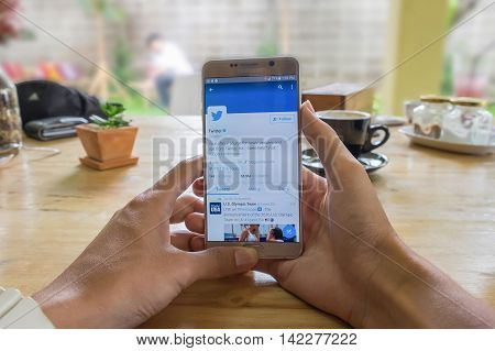 CHIANGMAI THAILAND - JULY 242016:Samsung note 5 open Twitter applicationTwitter is an online social networking and microblogging service that enables users to send and read