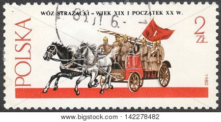 MOSCOW RUSSIA - CIRCA MAY 2016: a post stamp printed in POLAND shows a Horse-drawn Fire Engine the series