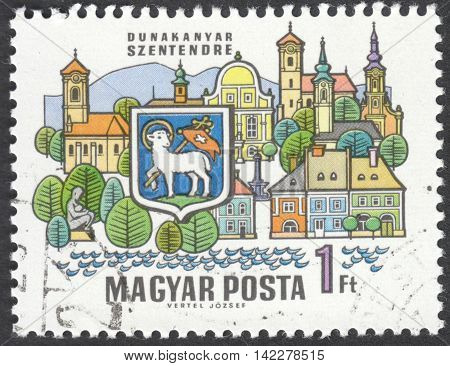 MOSCOW RUSSIA - CIRCA MAY 2016: a post stamp printed in HUNGARY shows coat of arms and buildings of Szentendre the series