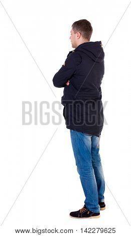 Back view of handsome man in winter jacket  looking up.   Standing young guy in parka. Rear view people collection.  backside view of person.  Isolated over white background. Man in warm jacket is