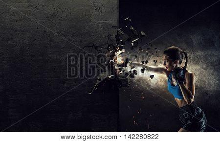 Young boxer woman . Mixed media