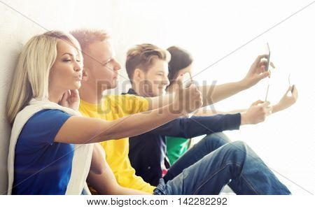 Group of hipsters taking selfie. Happy teenage students on a break at school.