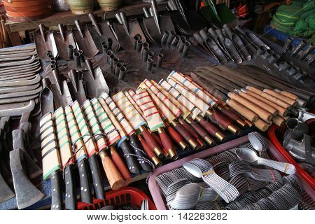 Various metal tools and implements in a market in Phomsavan Laos. Markets like this provide the local people with their everyday needs.