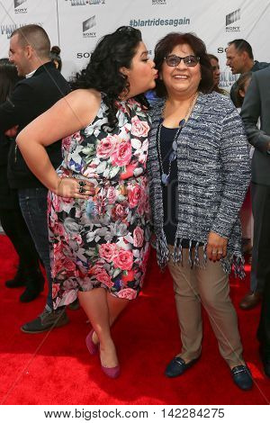 NEW YORK-APR 11: Actress Raini Rodriguez (L) and mother Diane Rodriguez attend the world premiere of