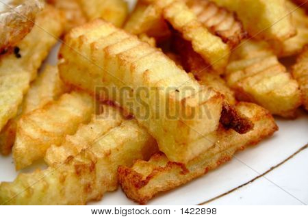 Fried Potatoes On White Plate