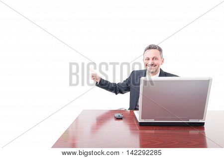 Cheerful Businessman Poiting On Copyspace