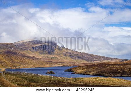 The famous Old Man of Storr on the Isle of Skye on a sunny spring day with blue sky and clouds - Scotland, UK
