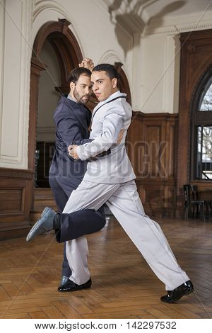 Confident Male Tango Dancers Performing Gancho