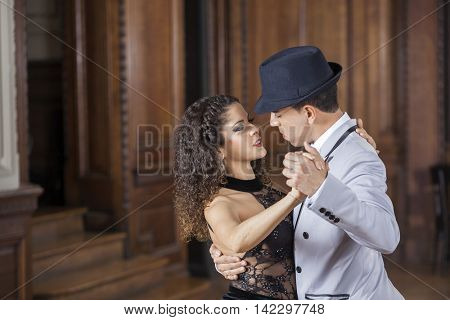 Confident Male And Female Partners Performing Tango
