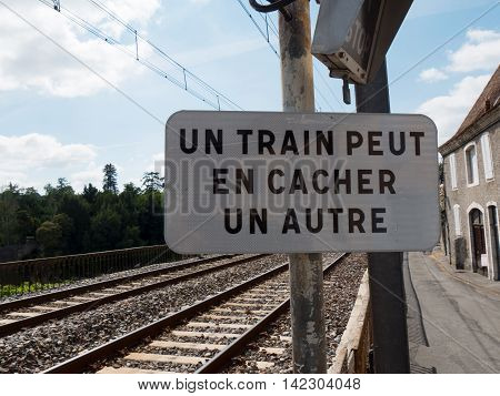 a french railway with a traffic sign