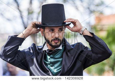 CAGLIARI, ITALY - June 1, 2014: Sunday at La Grande Jatte public gardens - Sardinia - portrait of a man in Victorian costumes
