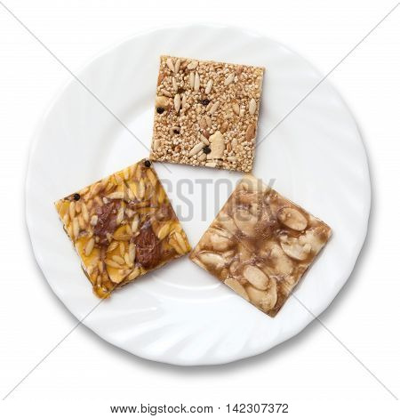 Various kinds of Indian sweet brittle on a plate