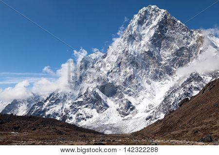 View of Cholatse Peak from route to Cho La Pass Three Passes Trek Solu Khumbu Nepal.