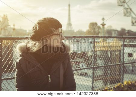 Female tourist enjoying city view on a street of Paris France. Toned Image. Concept Tourist in France