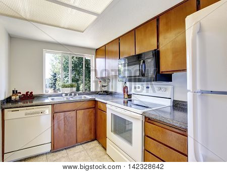 Small And Simple Kitchen Interior With White Appliances.